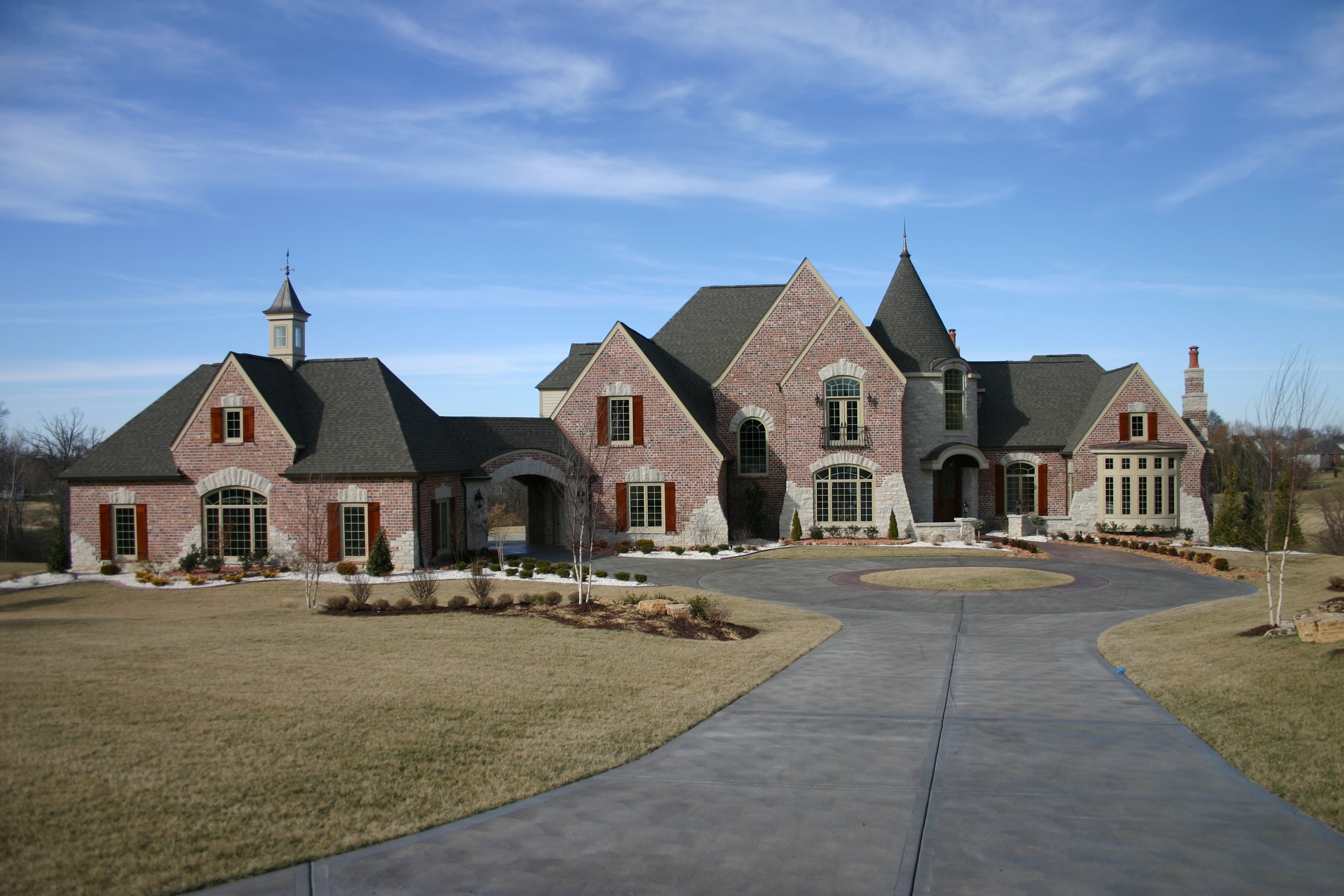 Large Brick House with Round Concrete Driveway