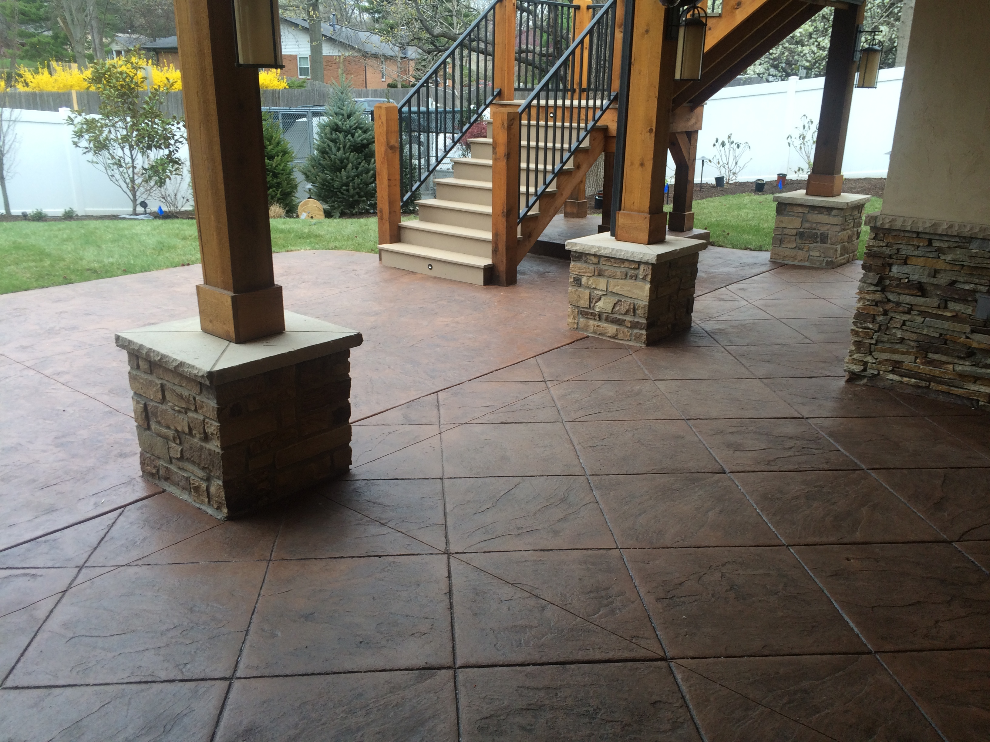 Brown Concrete Patio and Brick Pillars